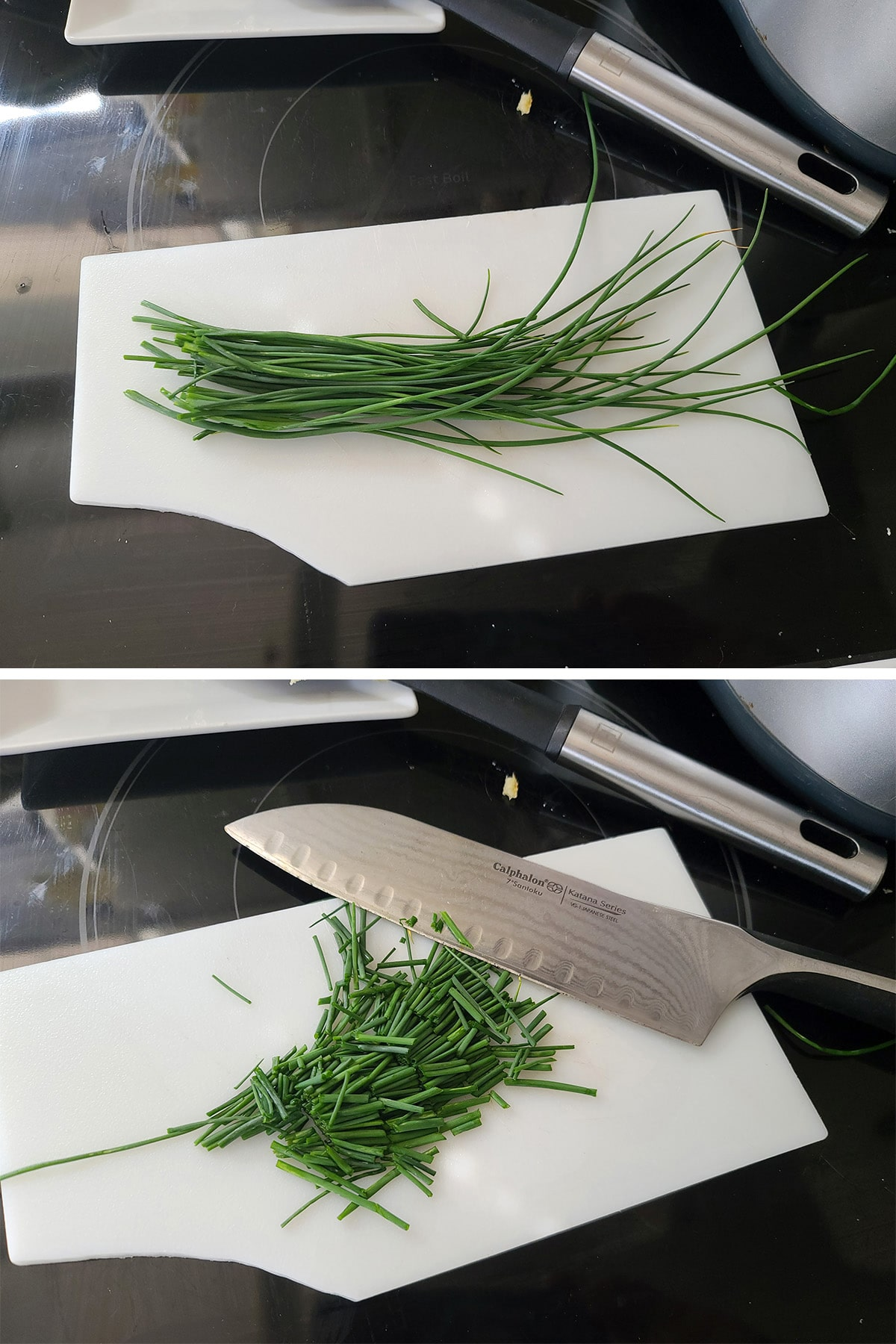 A white cutting board with chives being chopped on it.