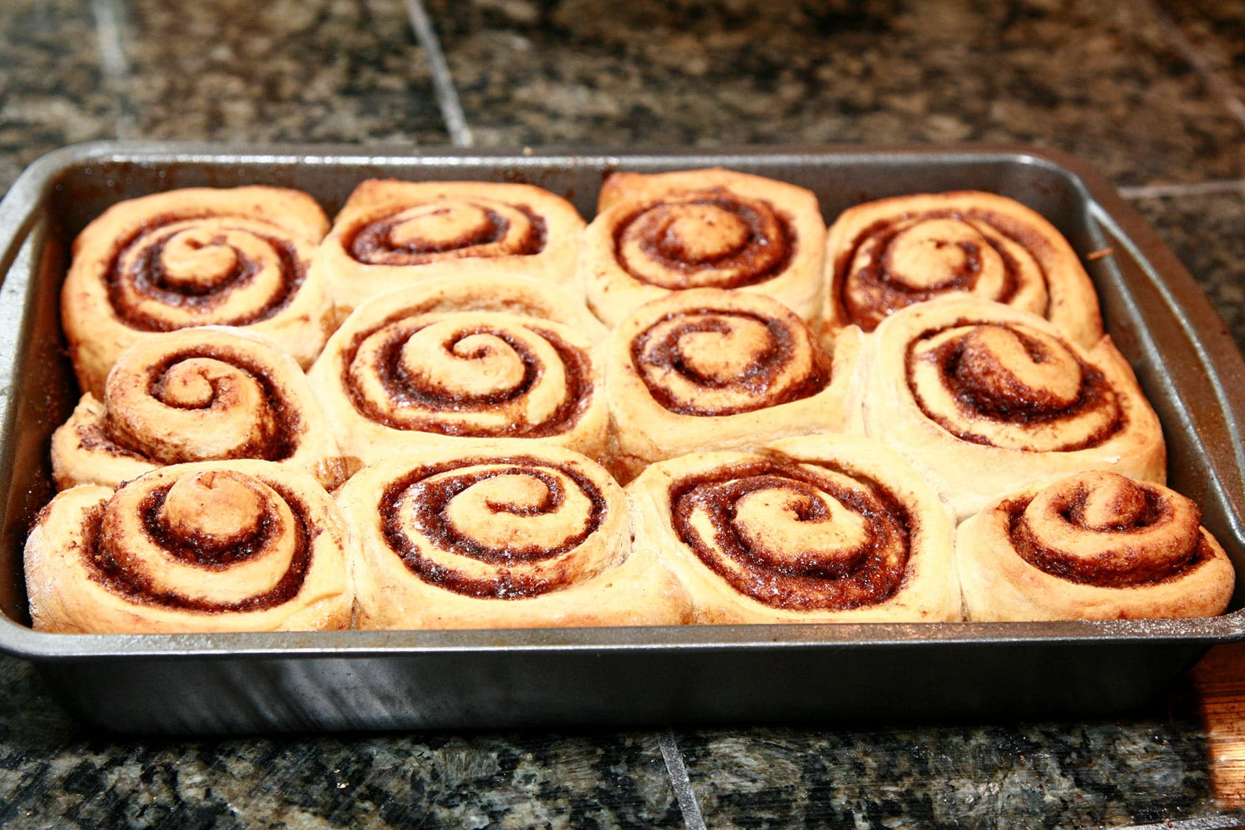 A pan of baked chai rolls.