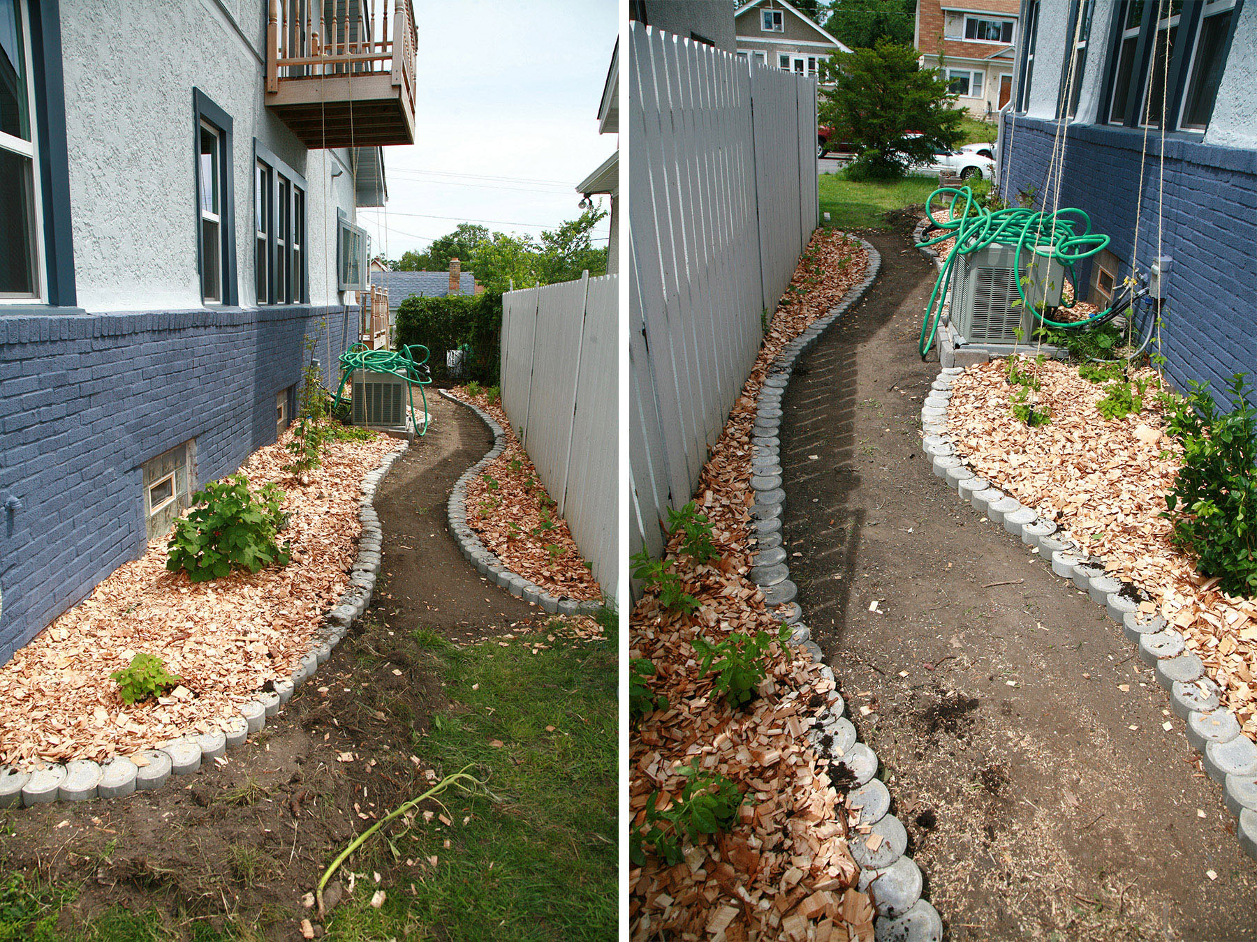 A stone-edged pathway has been nuilt into the side yard.