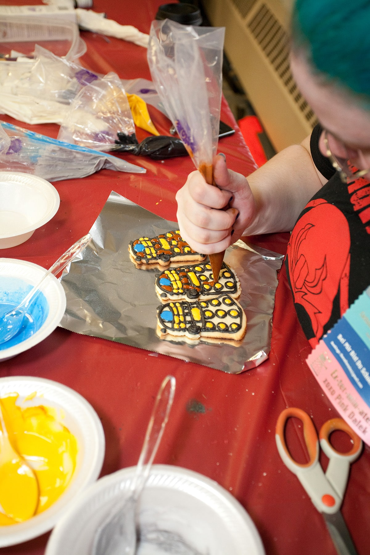 The author piping icing onto a Dalek cookie.