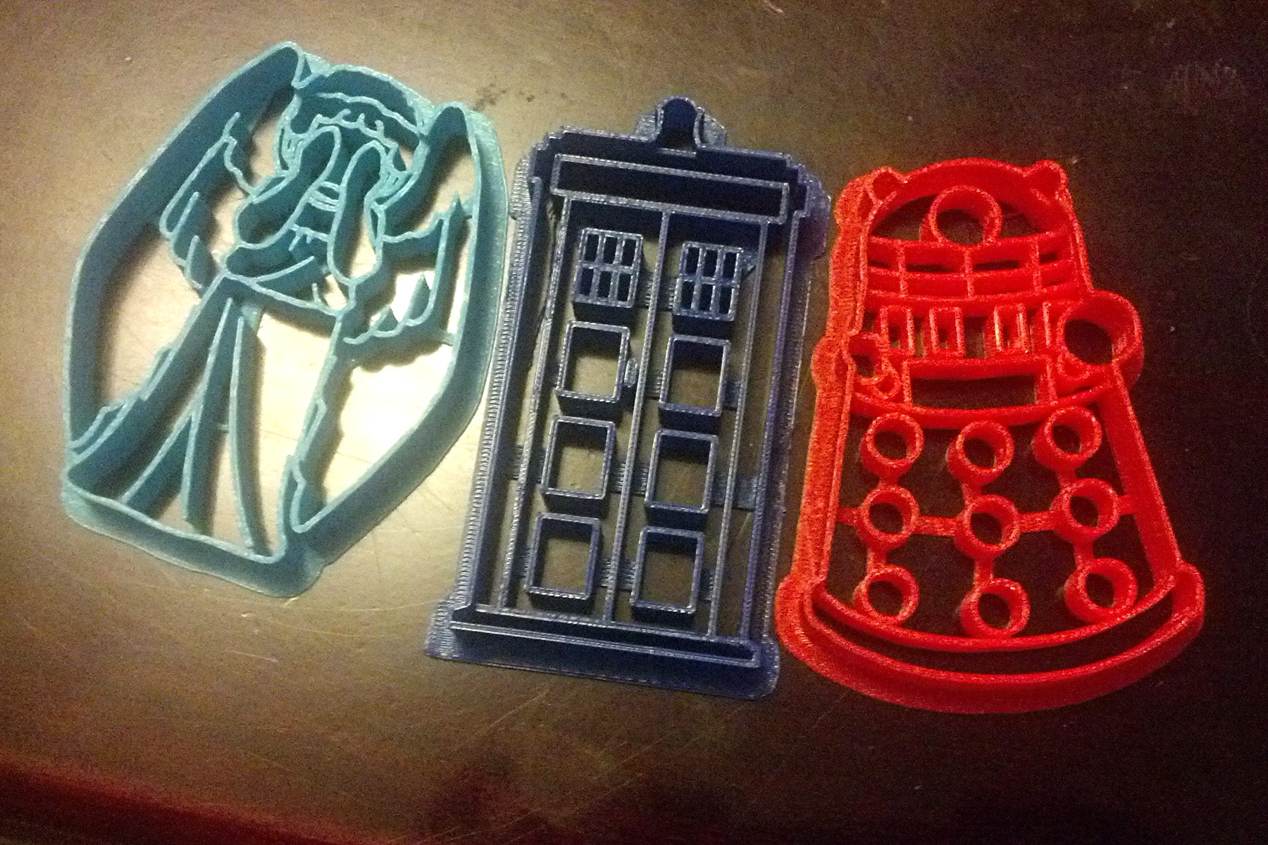 3 Doctor Who themed cookie cutters in a row. A Weeping Angel, a TARDIS, and a Dalek.