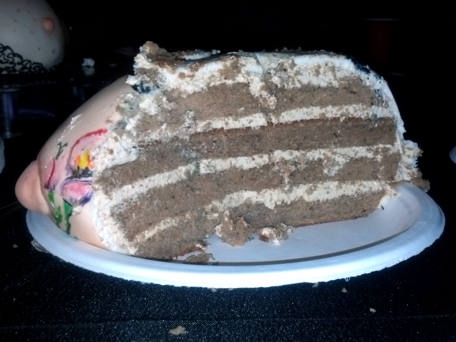 Cross section of the cake, 4 layers of chai cake, with frosting.