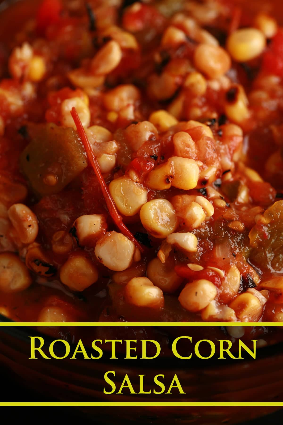 A close up view of roasted corn salsa for canning - corn salsa with tomatoes and peppers.