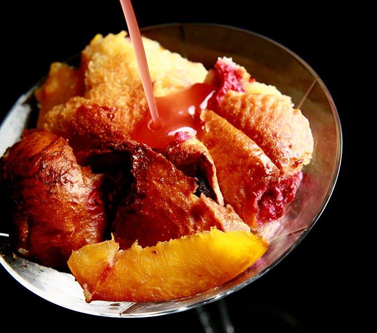 Boozy Raspberry-Peach Bread Pudding