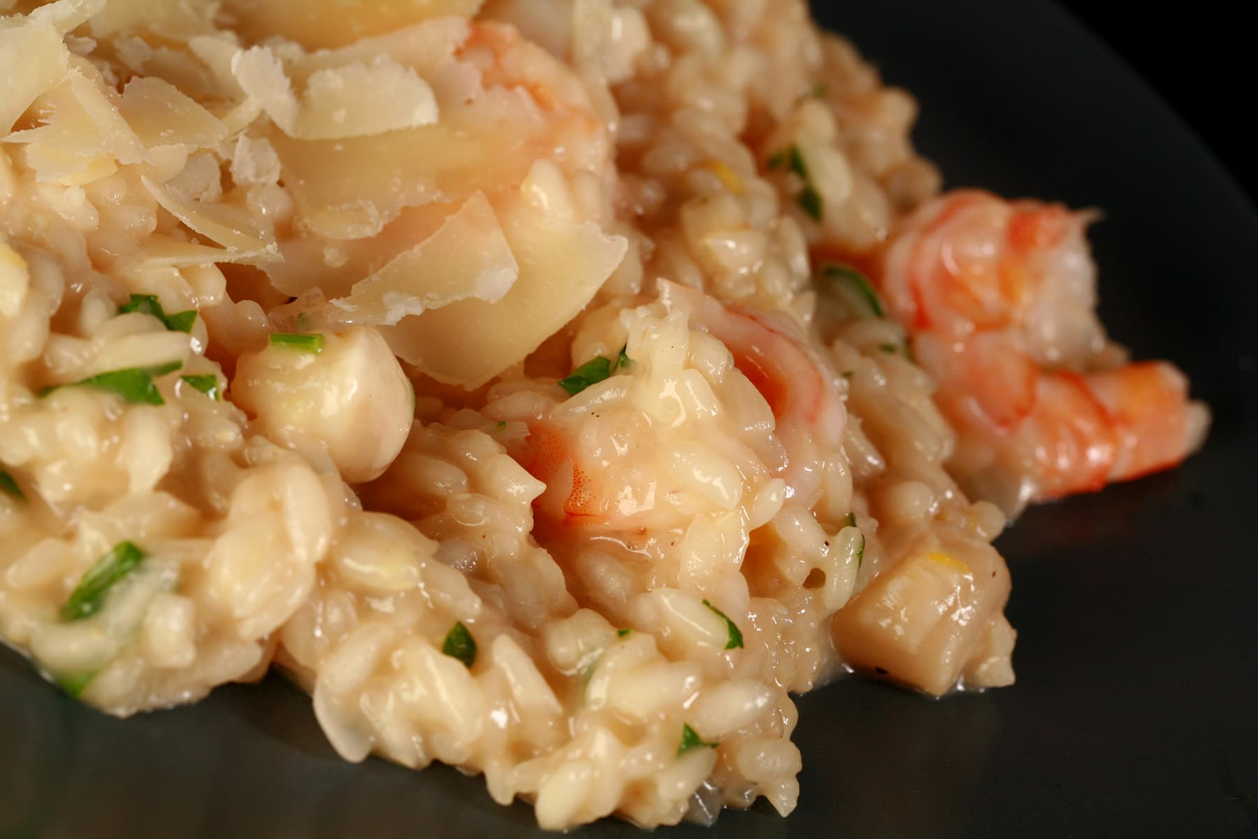 A close up view of seafood risotto on a plate.