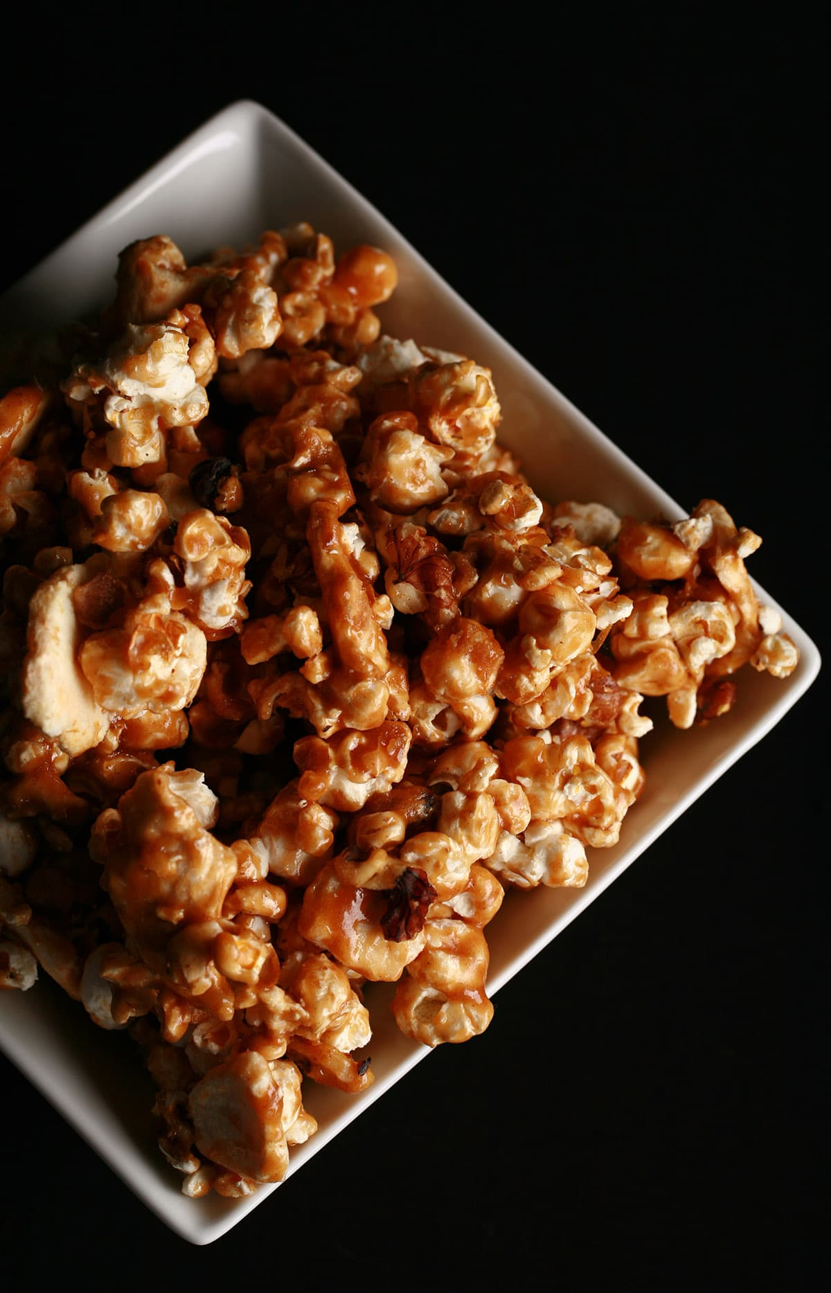 A close up view of a bowl of apple cinnamon caramel popcorn.