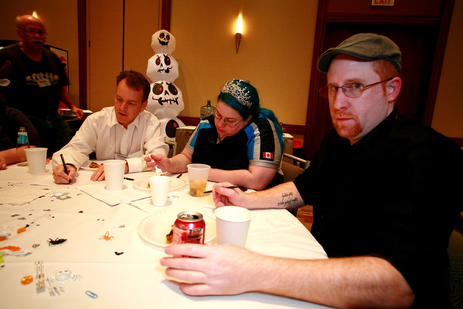 3 nerds sitting at a table.