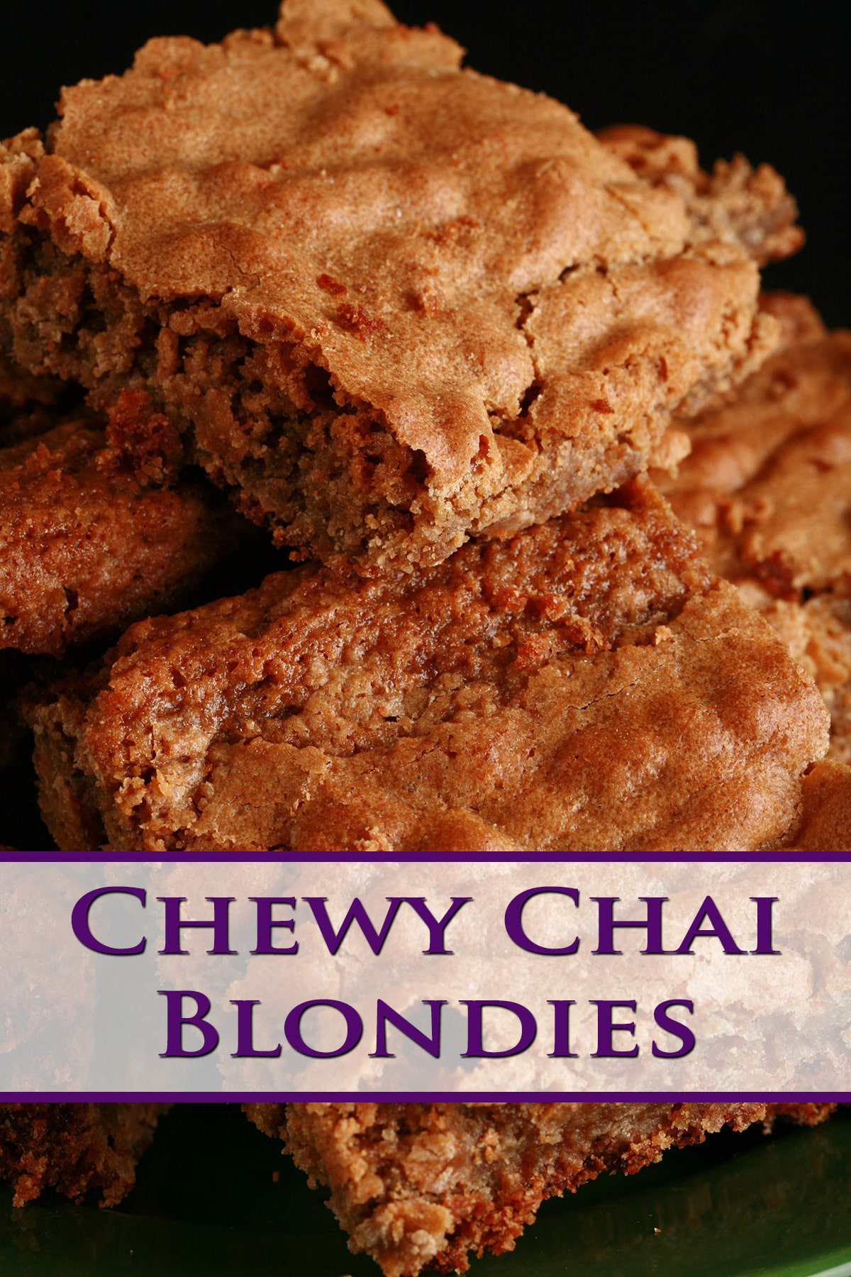 Several chewy chai blondies stacked on a small green plate.