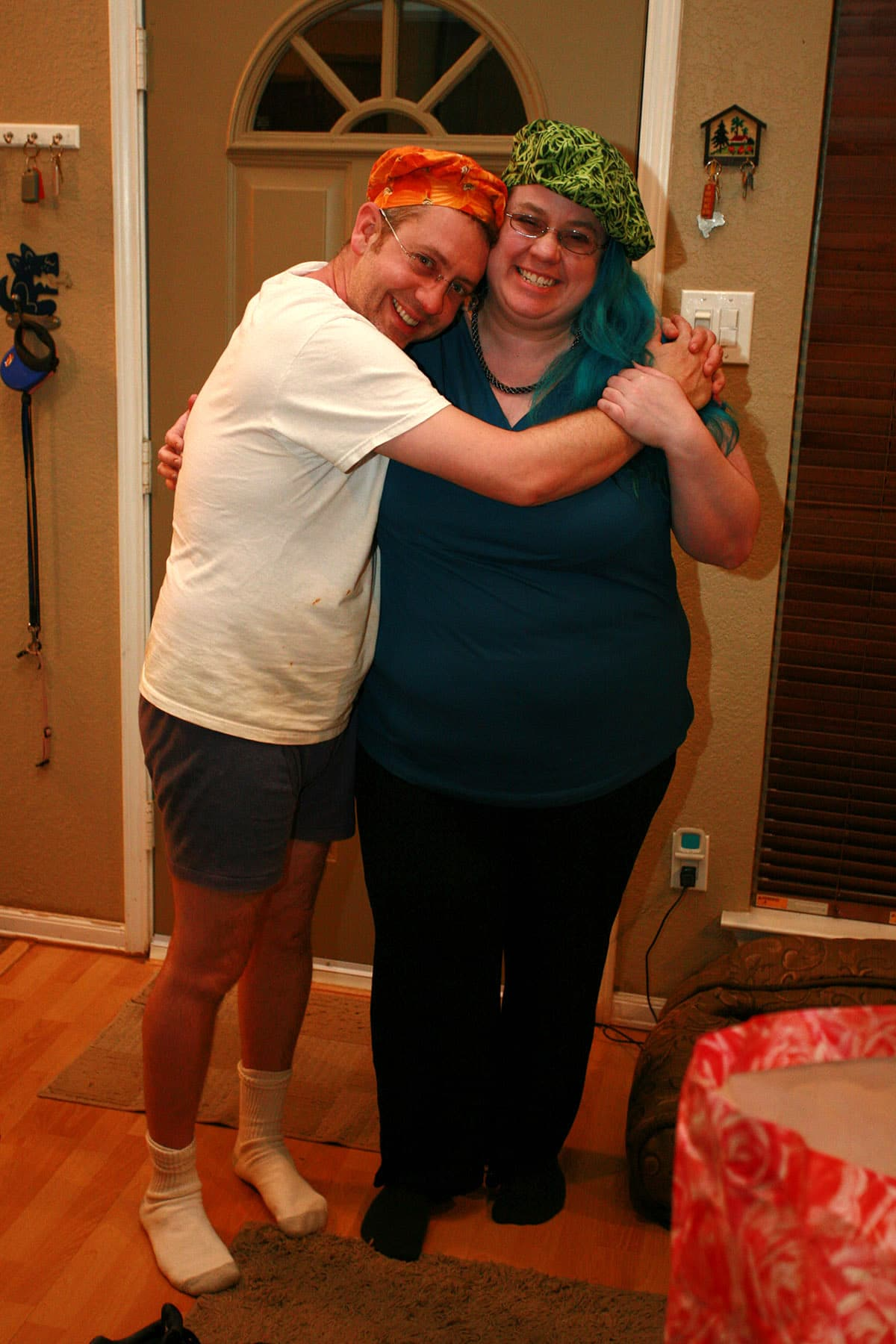 Ben Starr and Marie Porter, smiling at the camera and hugging.