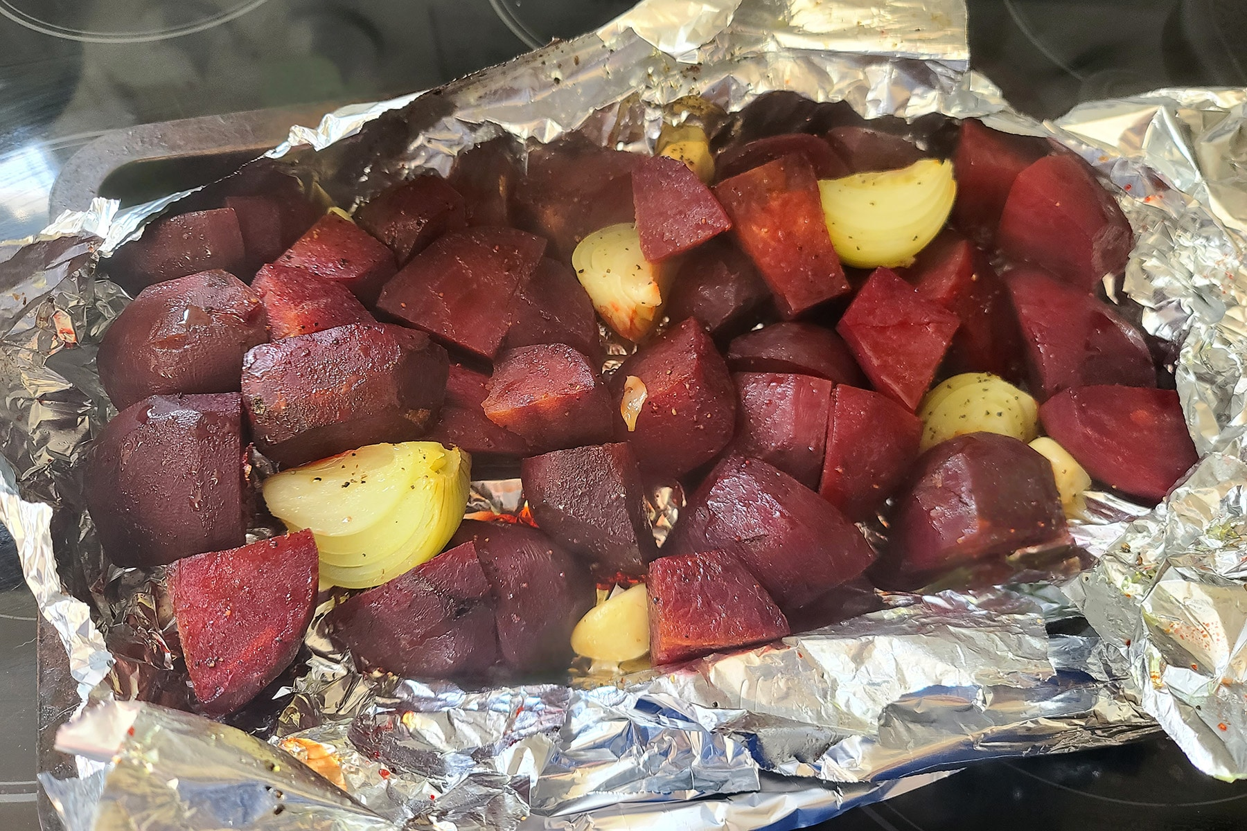 Roasted beets, onions, and garlic, fresh out of the oven.