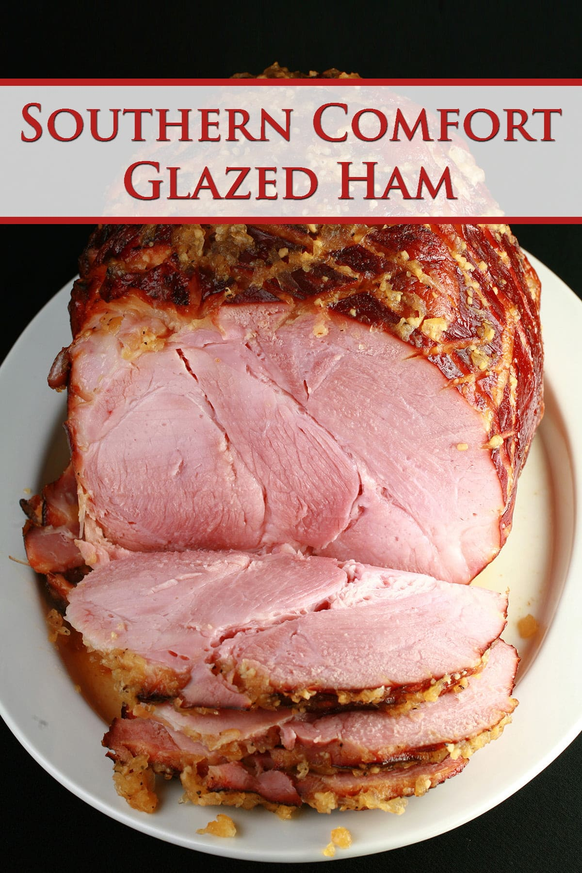 A large ham on a white platter.  There are several generous slices of ham in the foreground.