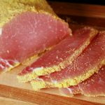 A cured loin of pork that has been rolled in cornmeal and sliced - proper peameal bacon!