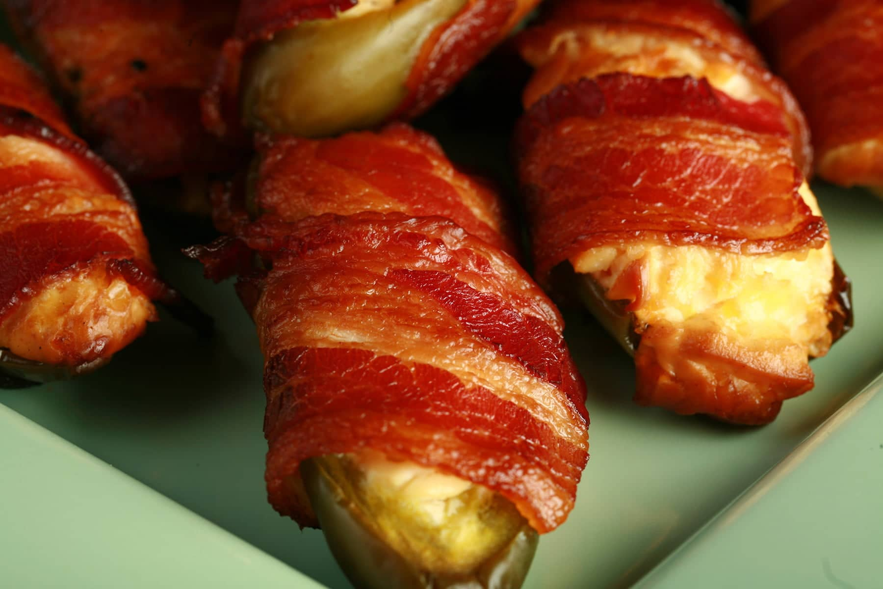 A close up photo of Smoked Bacon Jalapeno poppers