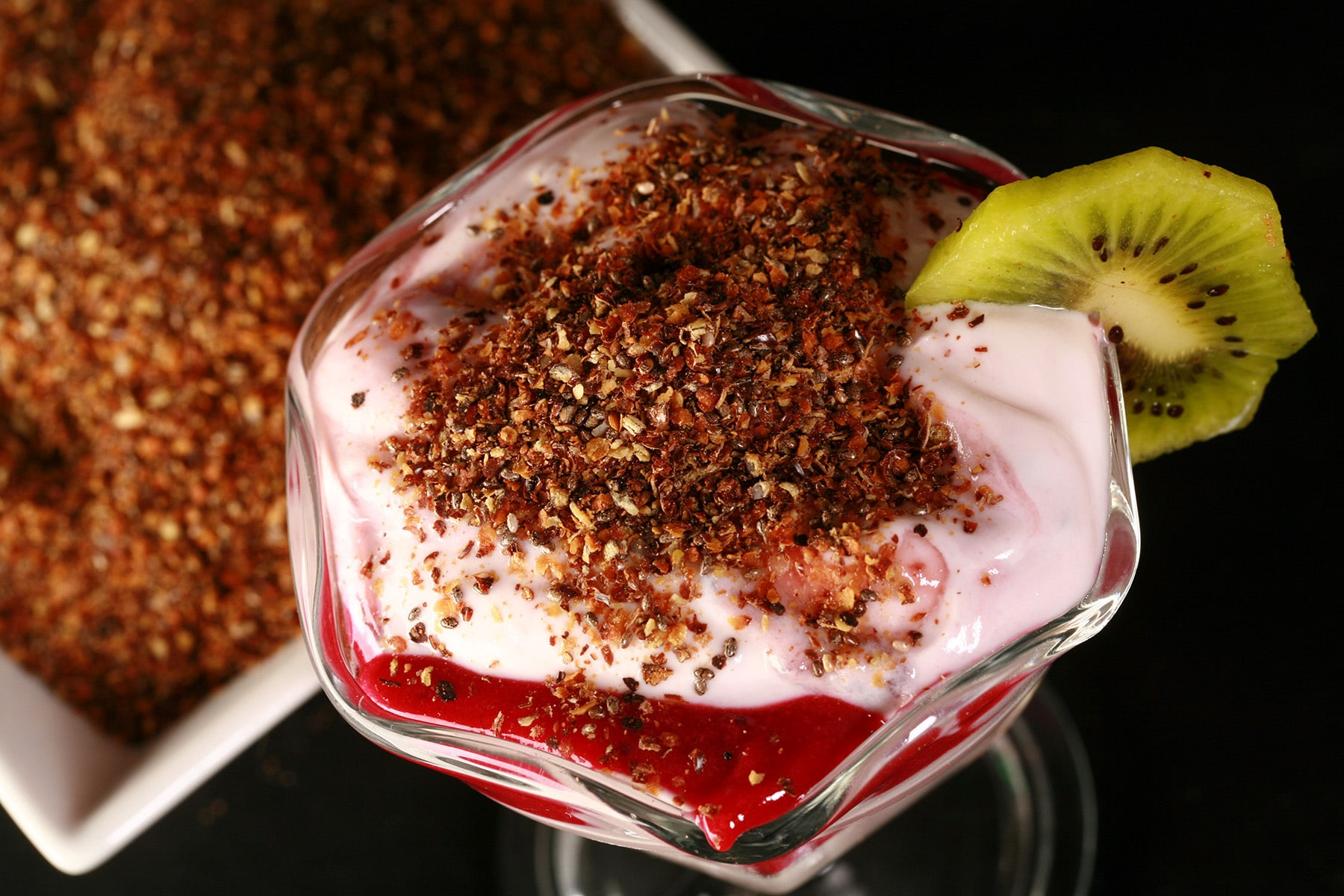 A parfait made with vanilla yogurt, blackcurrant curd, and our yogurt topping.
