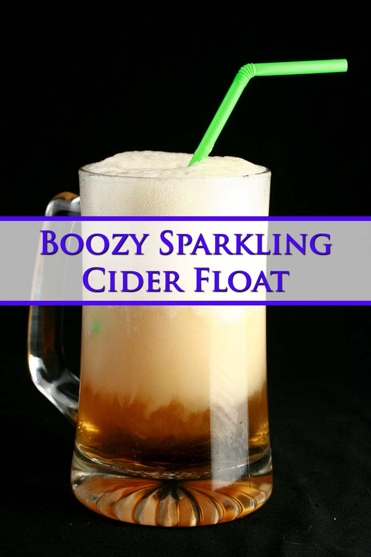 A tall beer stein with a sparkling apple cider float in it. Blue text overlay says boozy sparkling cider float.