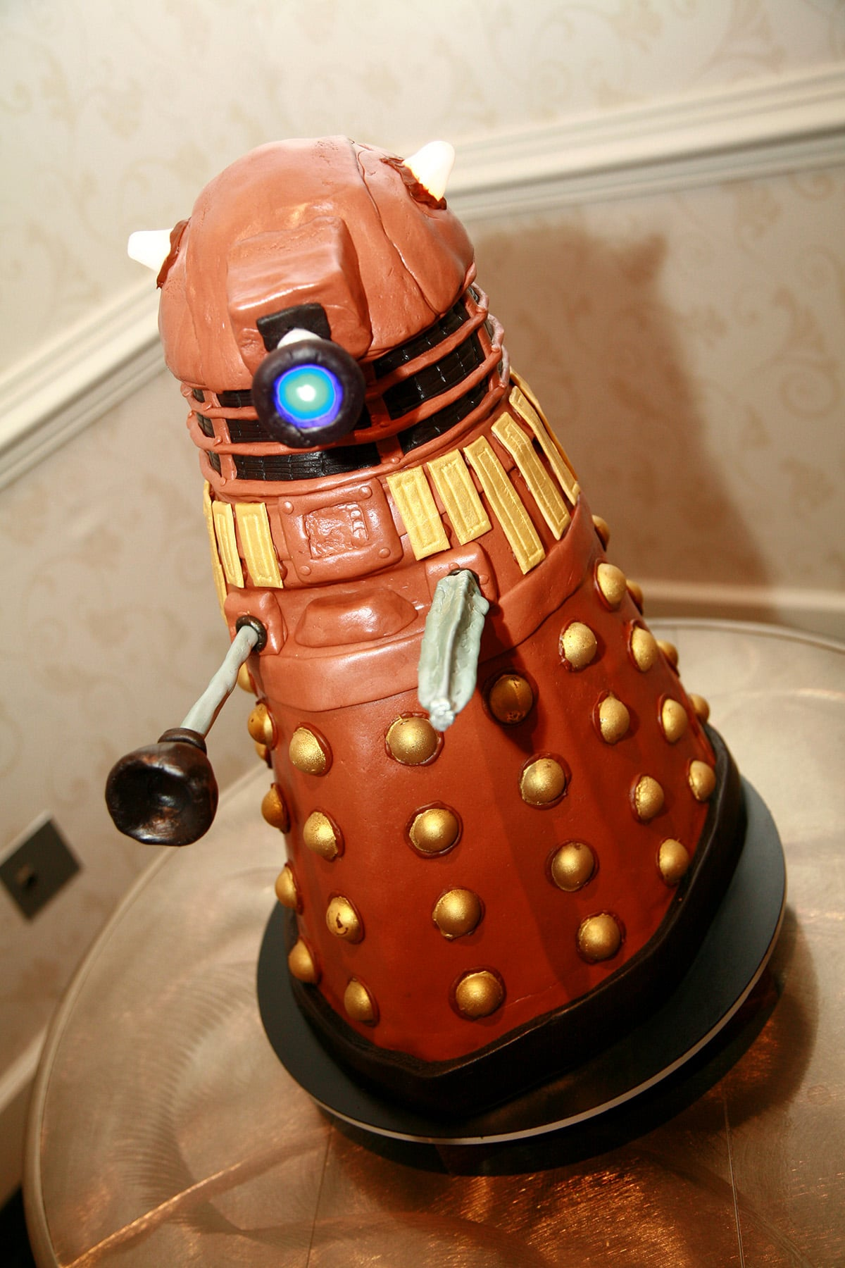 A tall dalek cake, with light up accents.