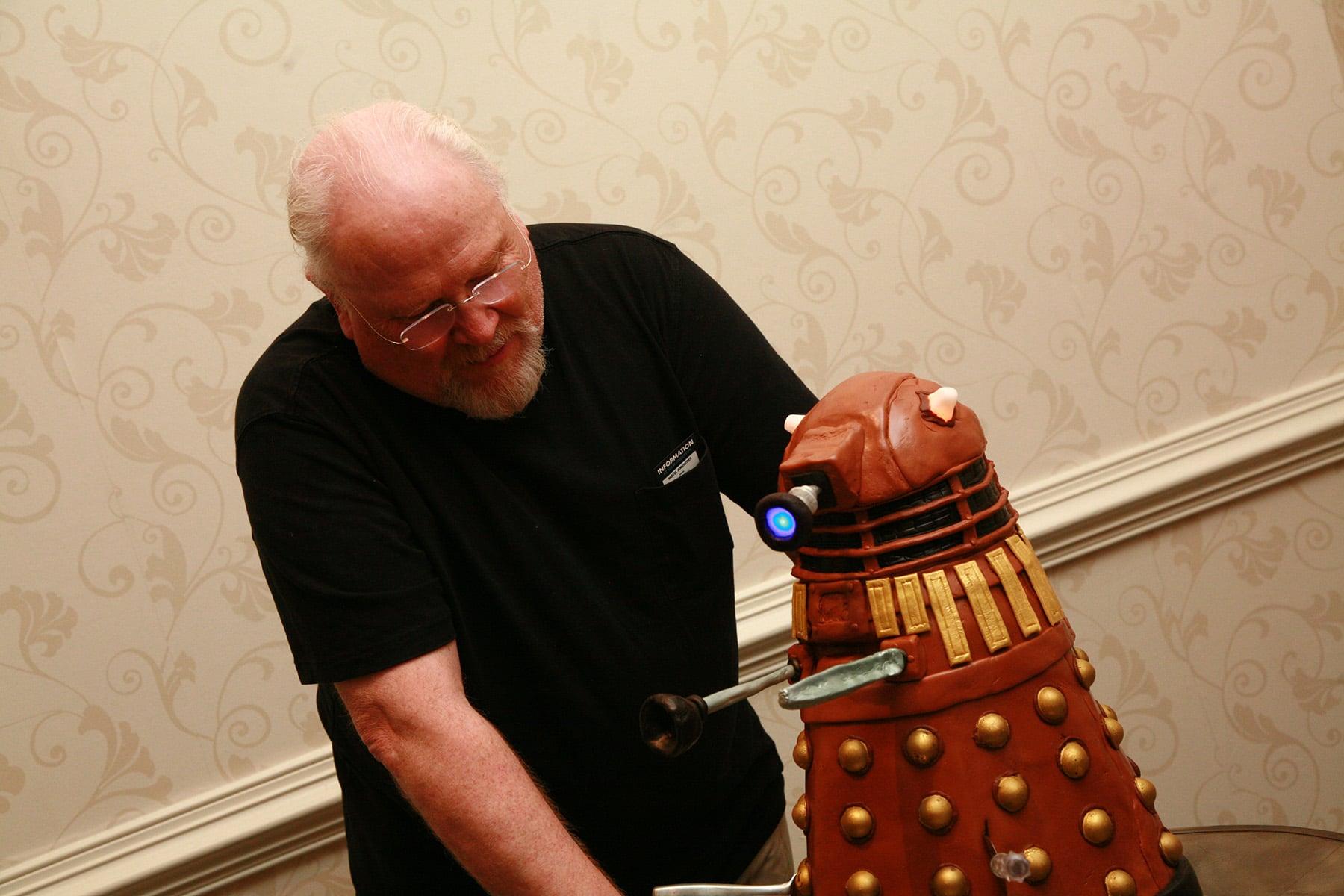 Colin Baker admiring the Dalek Cake