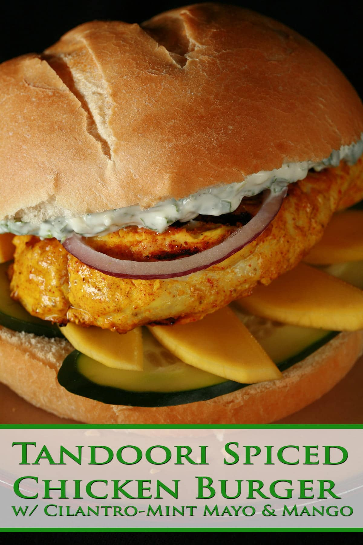 A Tandoori Spiced Chicken Burger: Tandoori Marinated chicken breast with cucumbers, mango, red onions, and a cilantro mint mayo.