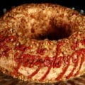 A large cheese ring, coated in nuts. Tolkien's black speech One Ring inscription has been piped on the side, in deep red sun dried tomato paste.