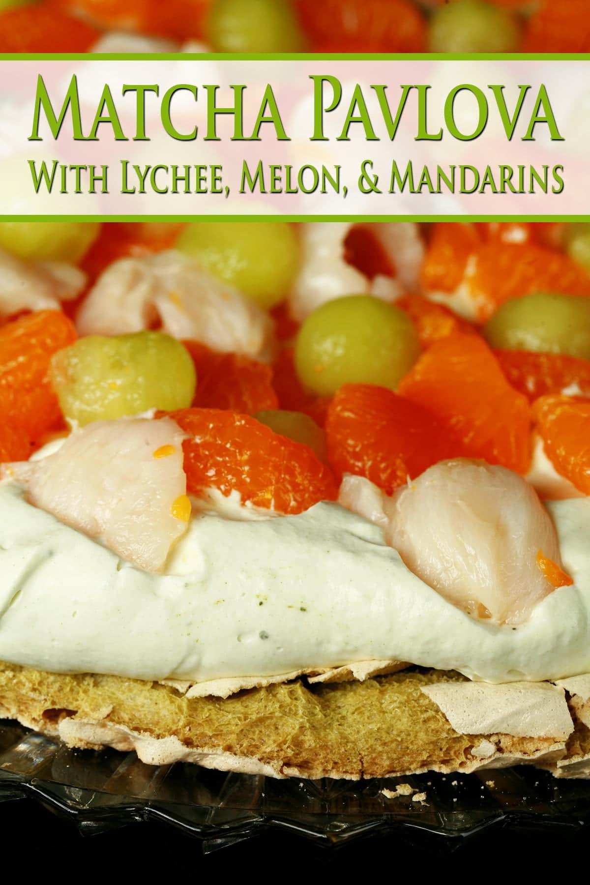 A Matcha Pavlova with Mandarin orange segments, lychee, and honeydew melon on top.