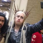 Cosplayers dressed as Thranduil and Radagast, taking a selfie.