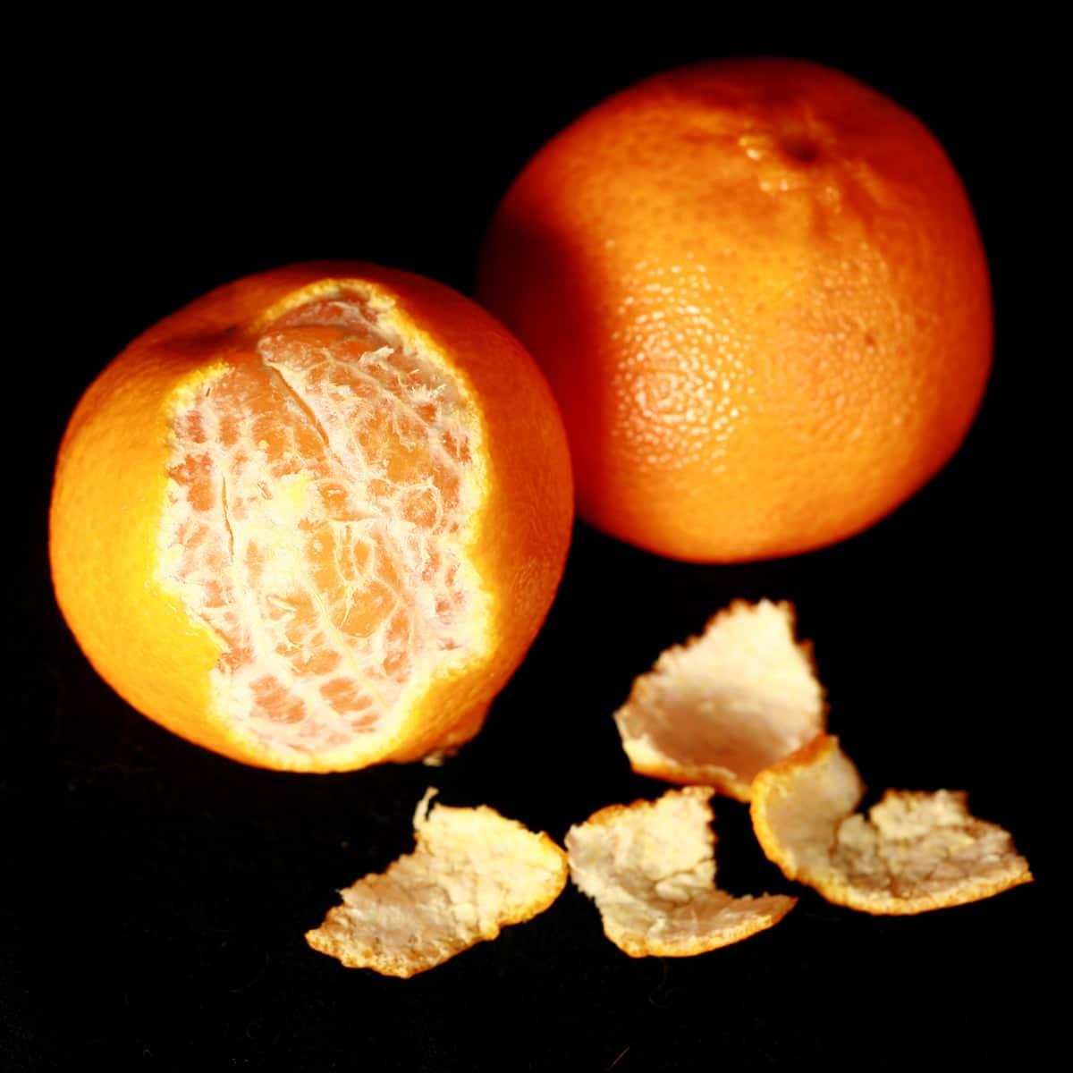 2 Halo Mandarin oranges, one peeled.