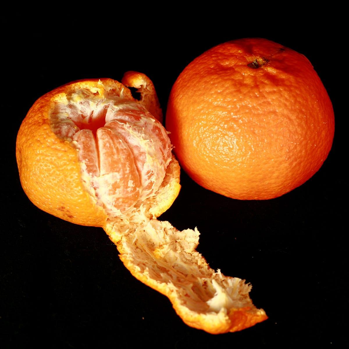 2 Algerian Mandarin oranges, one peeled.