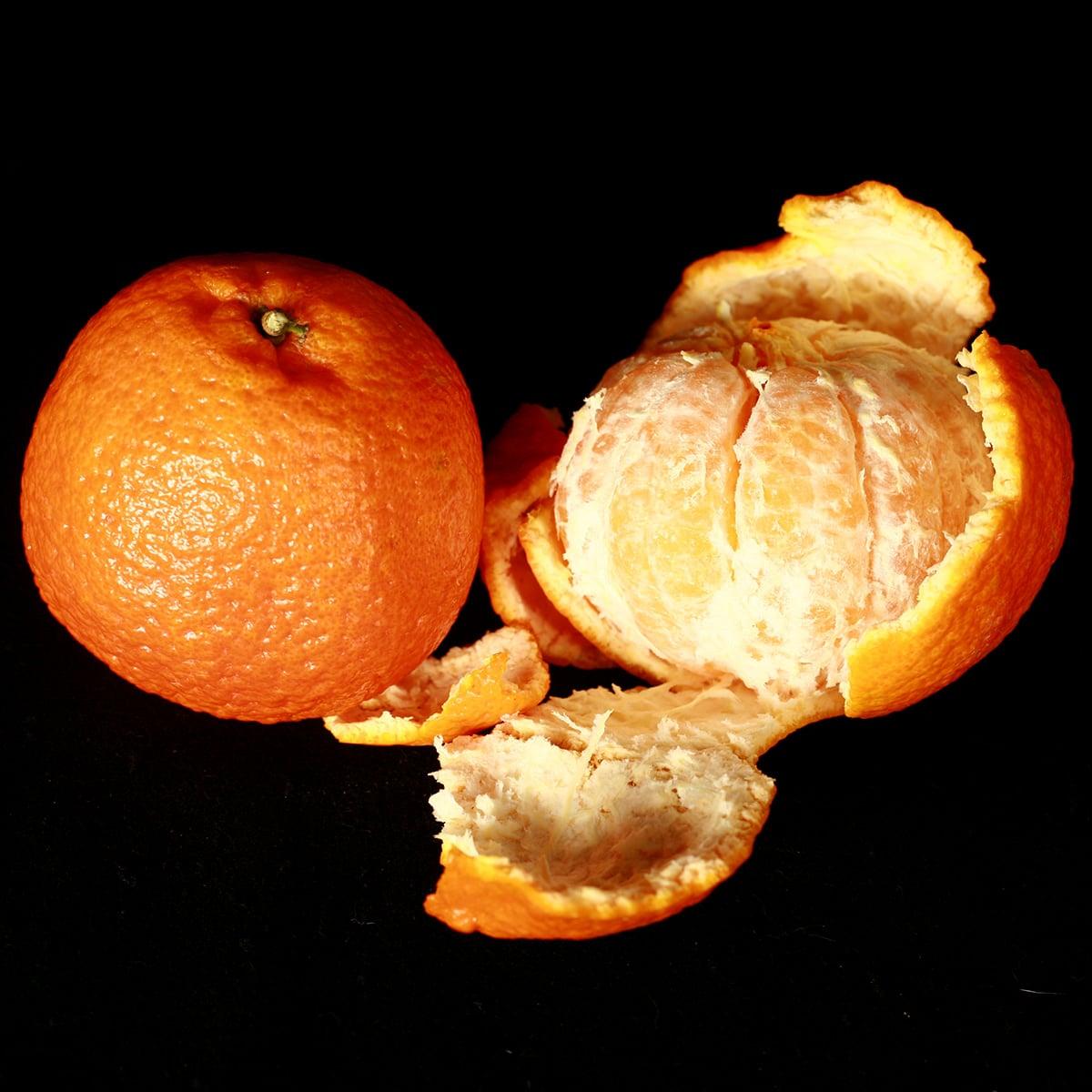 2 Mandarin oranges, one peeled.