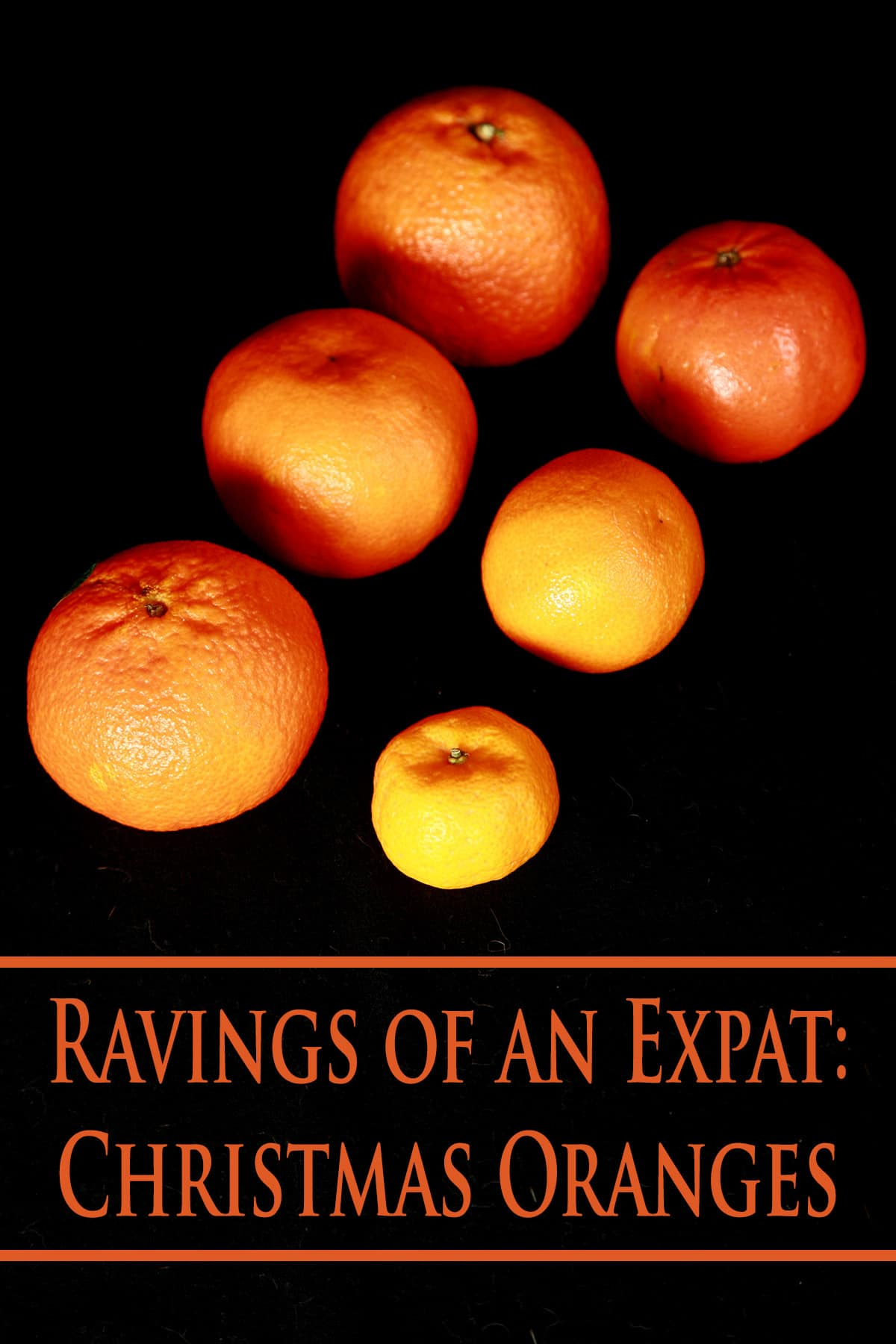 6 oranges on a black background, labelled Ravings of an Expat: Christmas Oranges.