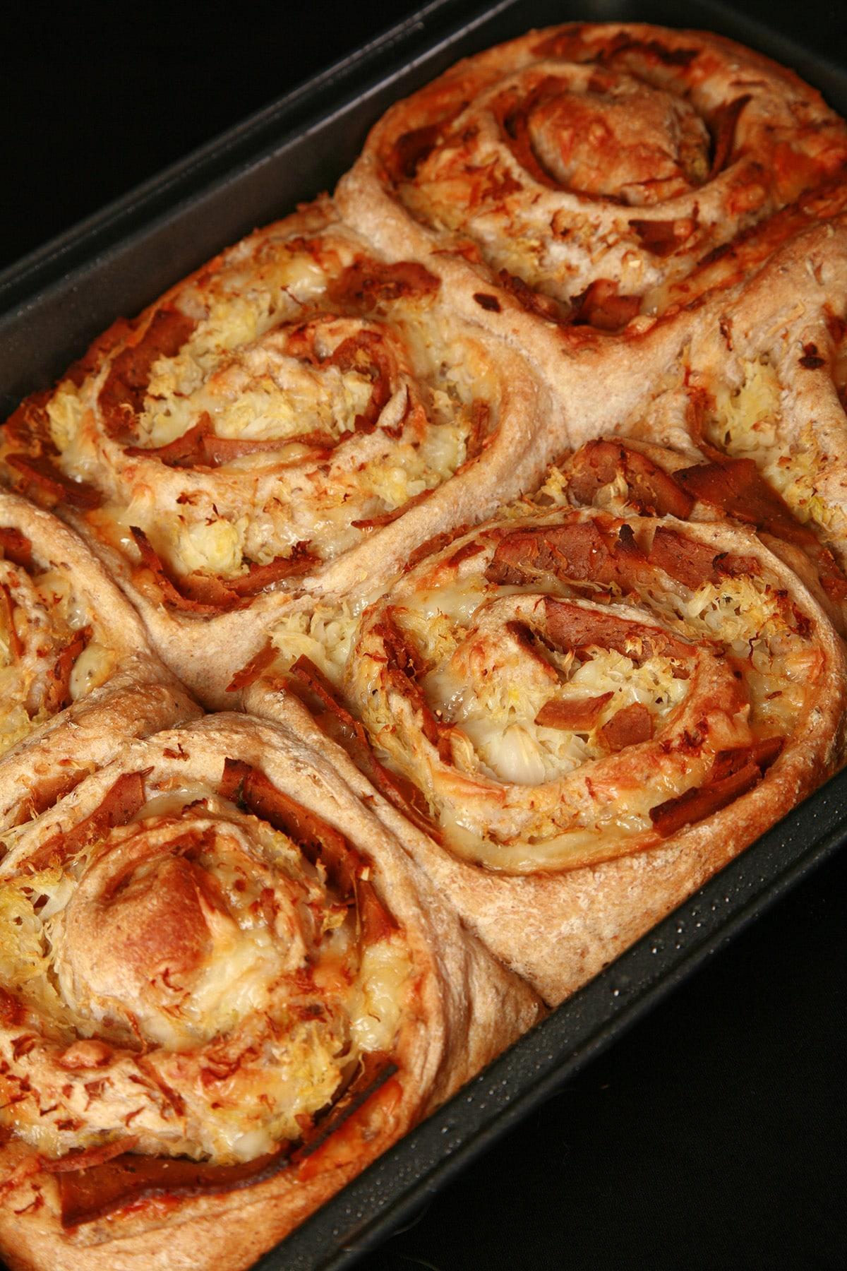 A pan of 6 Reuben buns.