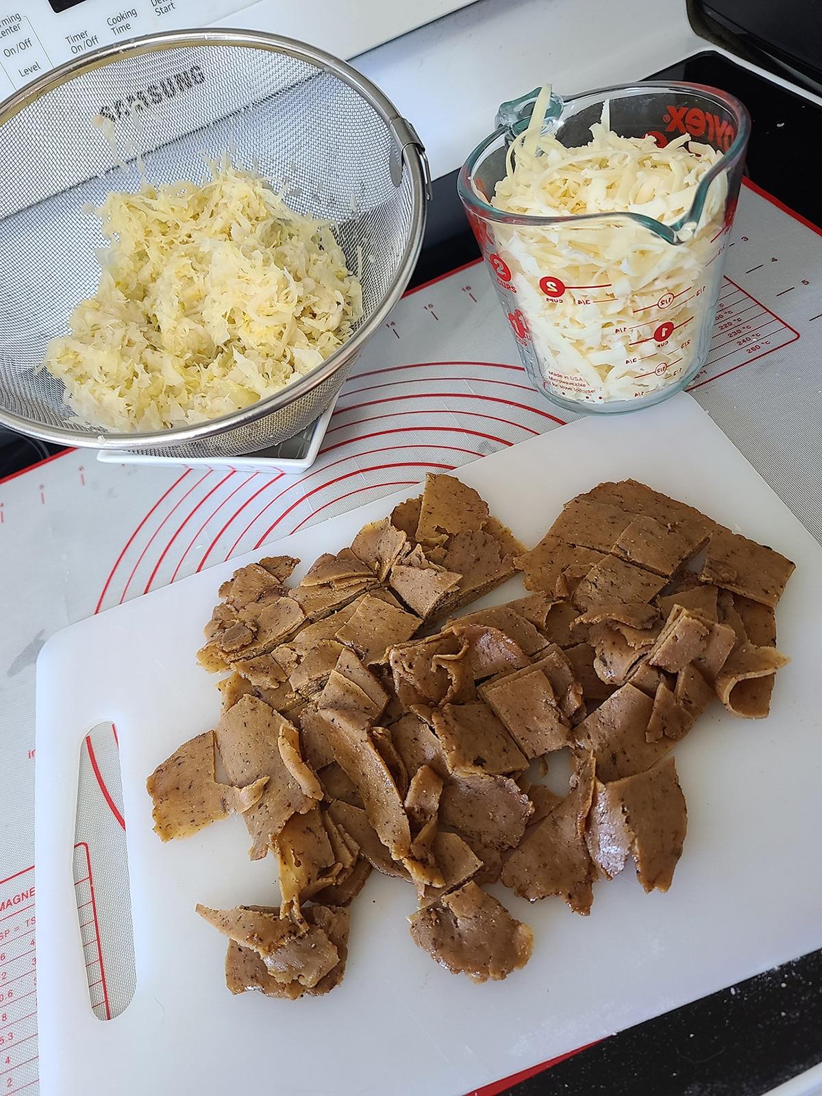 Chopped vegetarian pastrami, drained sauerkraut, and shredded Swiss cheese.