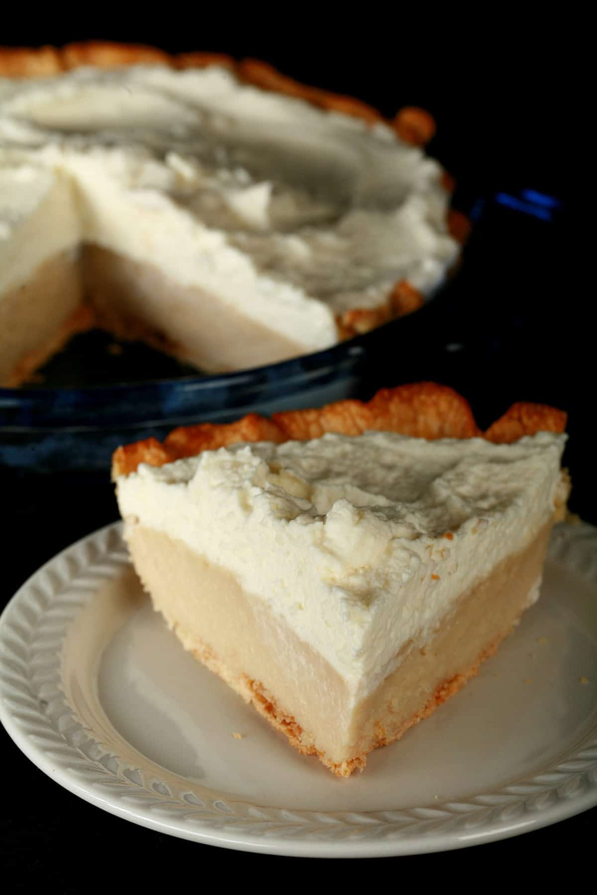 A Gluten-Free Earl Grey Pie - A greige custard pie, topped with whipped cream.