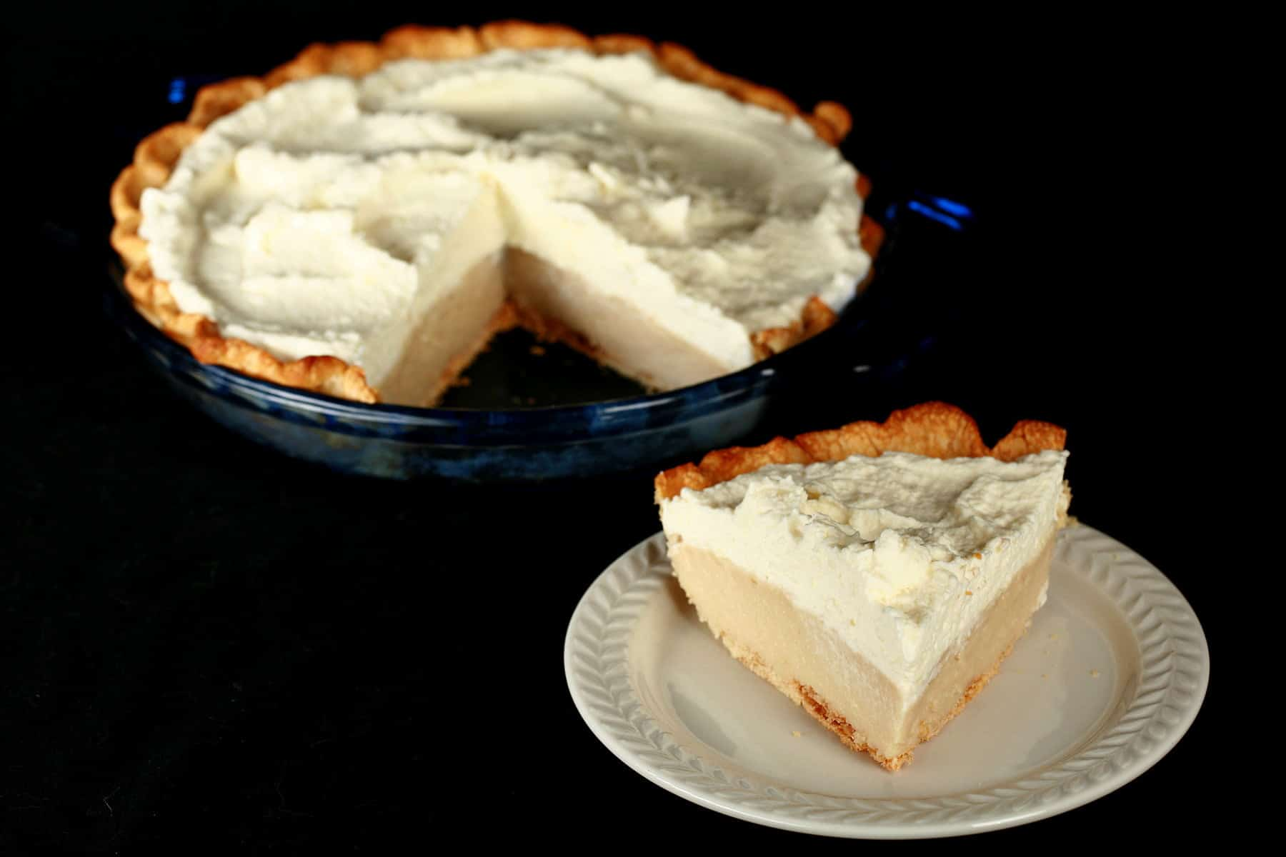 A Gluten-Free Earl Grey Cream Pie - A greige custard pie, topped with whipped cream.
