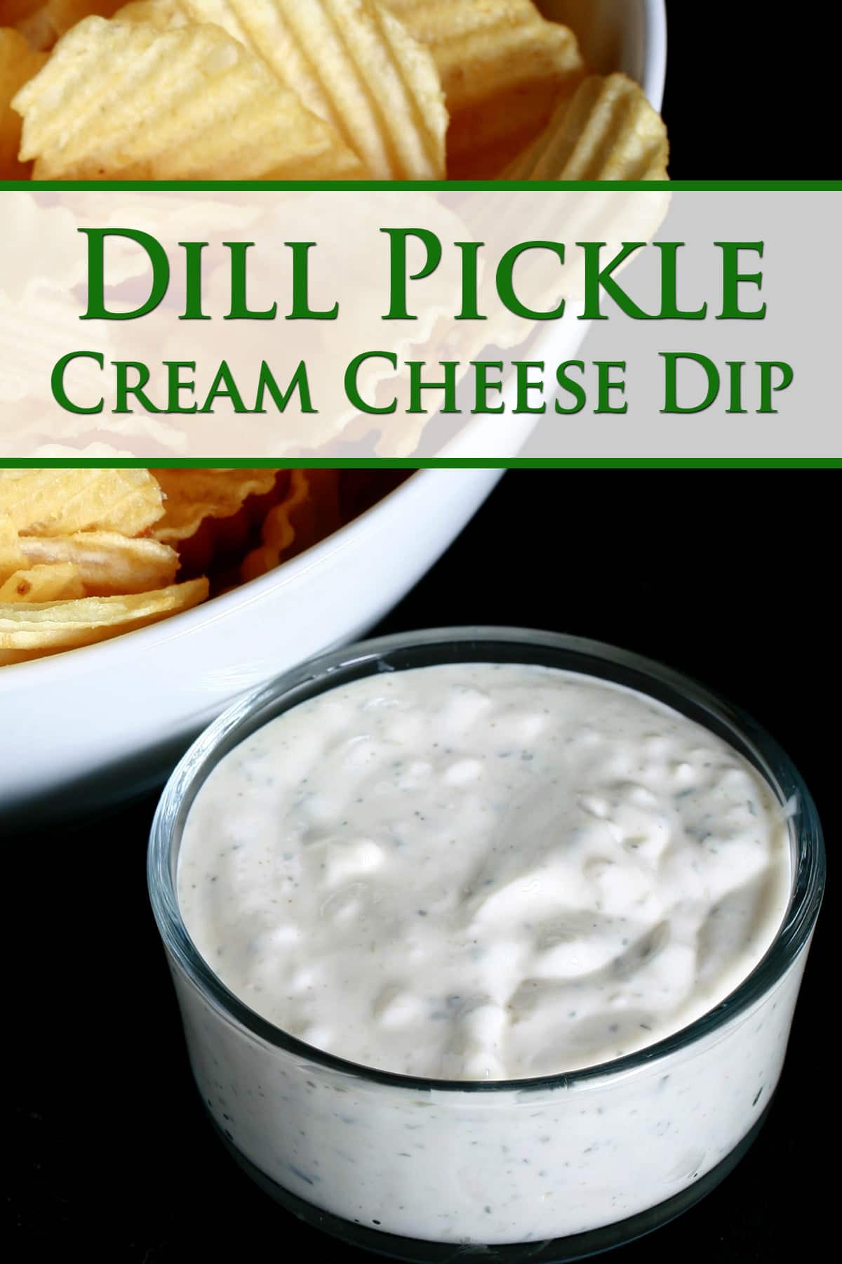 A close up view of a bowl of dill pickle cream cheese dip, next to a white bowl full of ripple chips.
