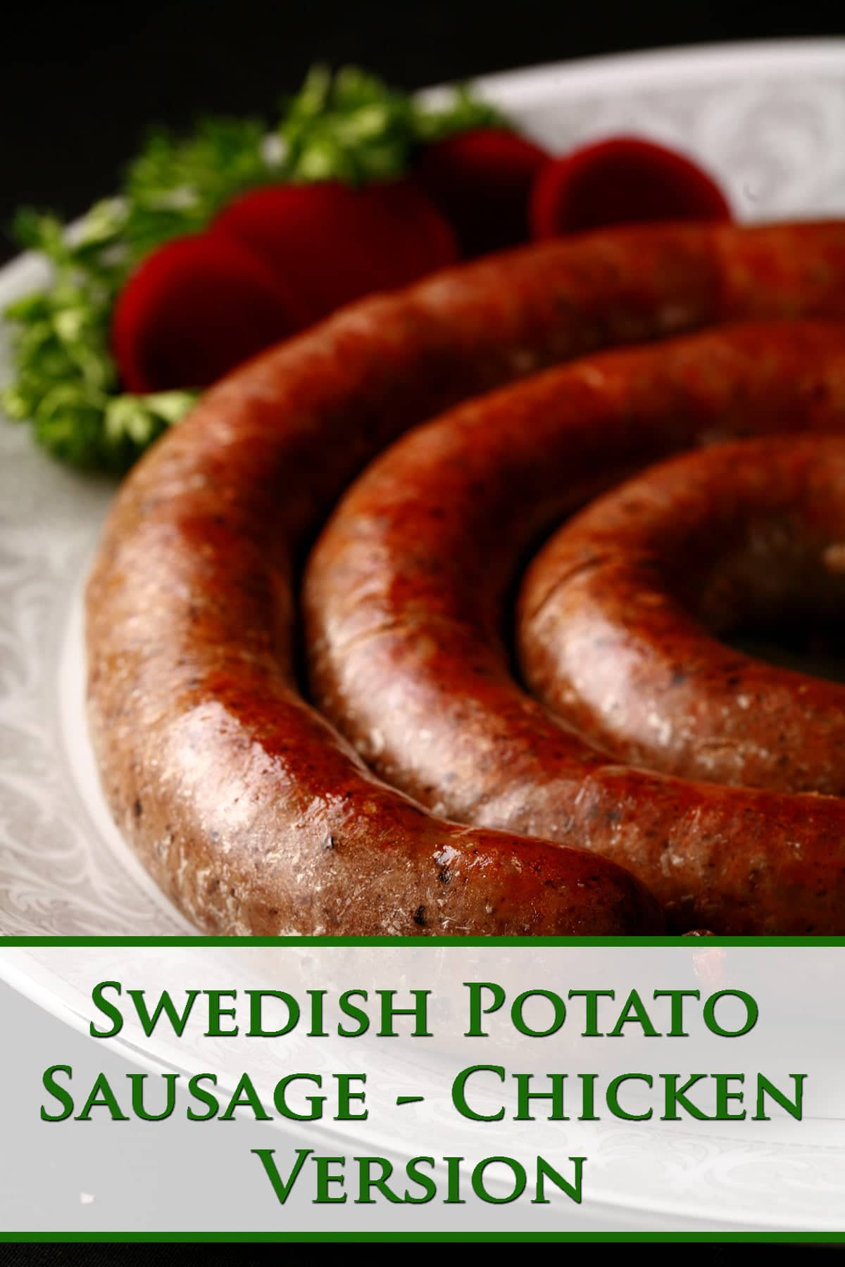 A large coil of sausage on a white plate. It's garnished with slices of beet pickles and some parsley.