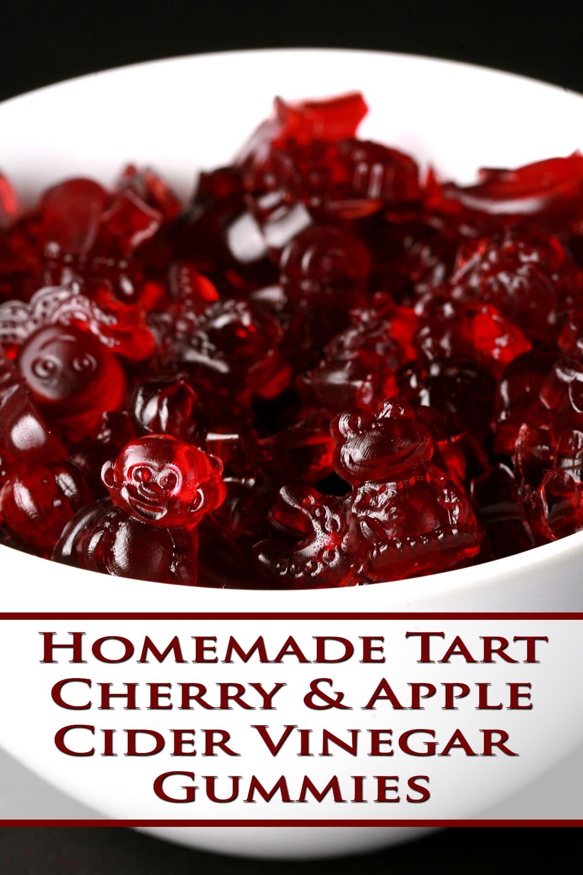A white bowl full of tart cherry apple cider vinegar gummies, in various animal shapes.