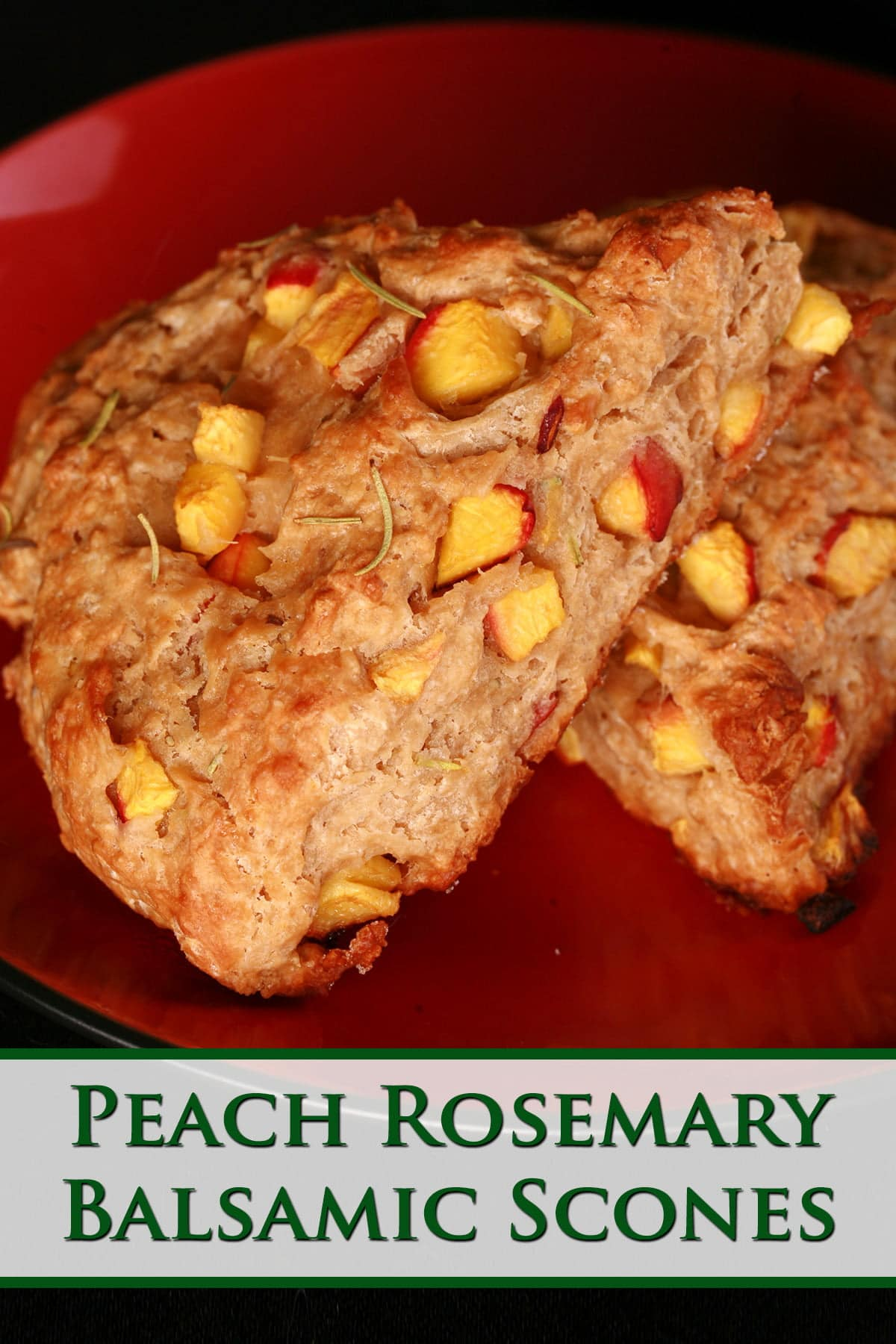 Two wedges of Rosemary Peach Balsamic Scones on a red plate. The scones are studded with visible chunks of peach.