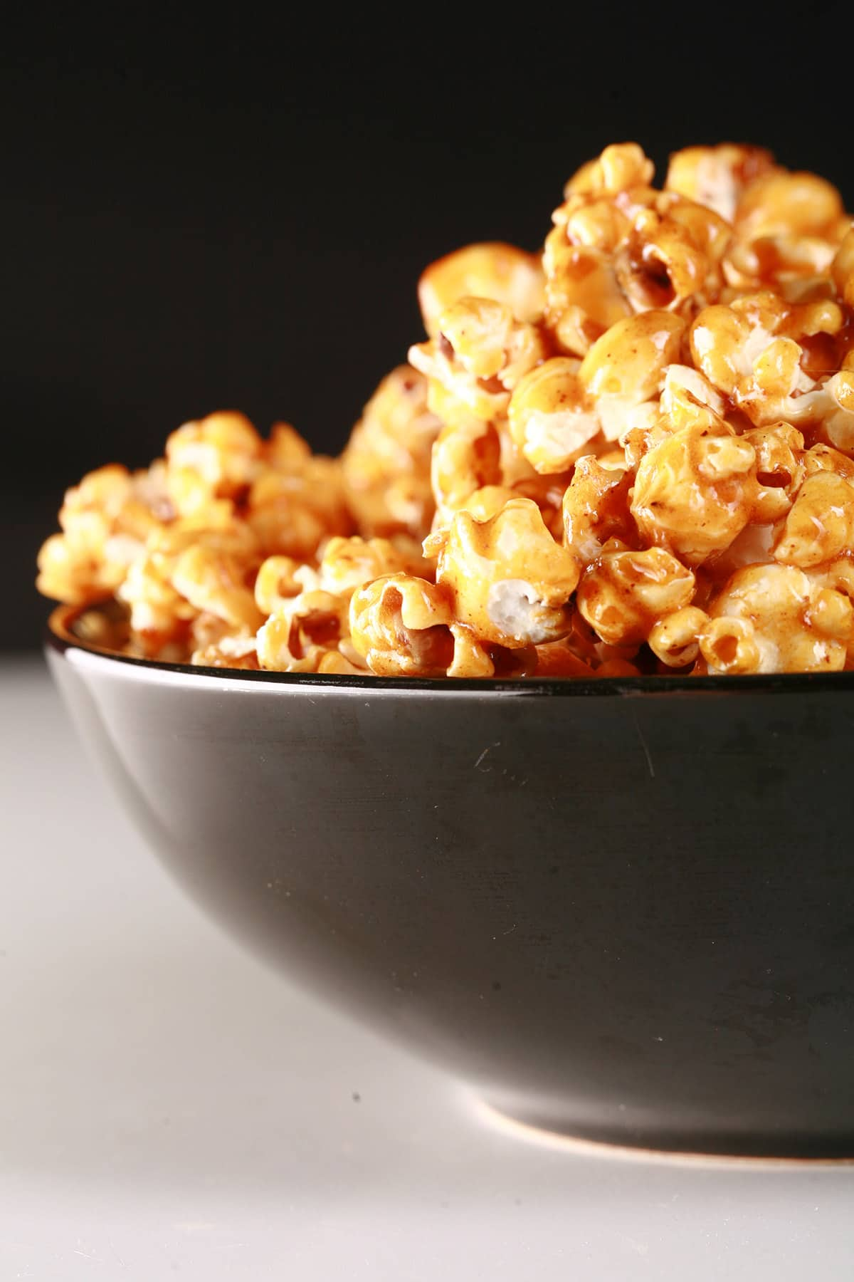 Close up view of a bowl of sweet heat salted caramel popcorn.