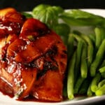 Balsamic Glazed chicken breast, with peacjes and basil on top, green beans on the side.