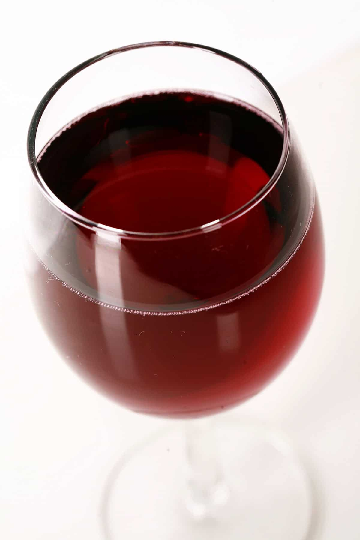 Close up view of a glass of red wine.