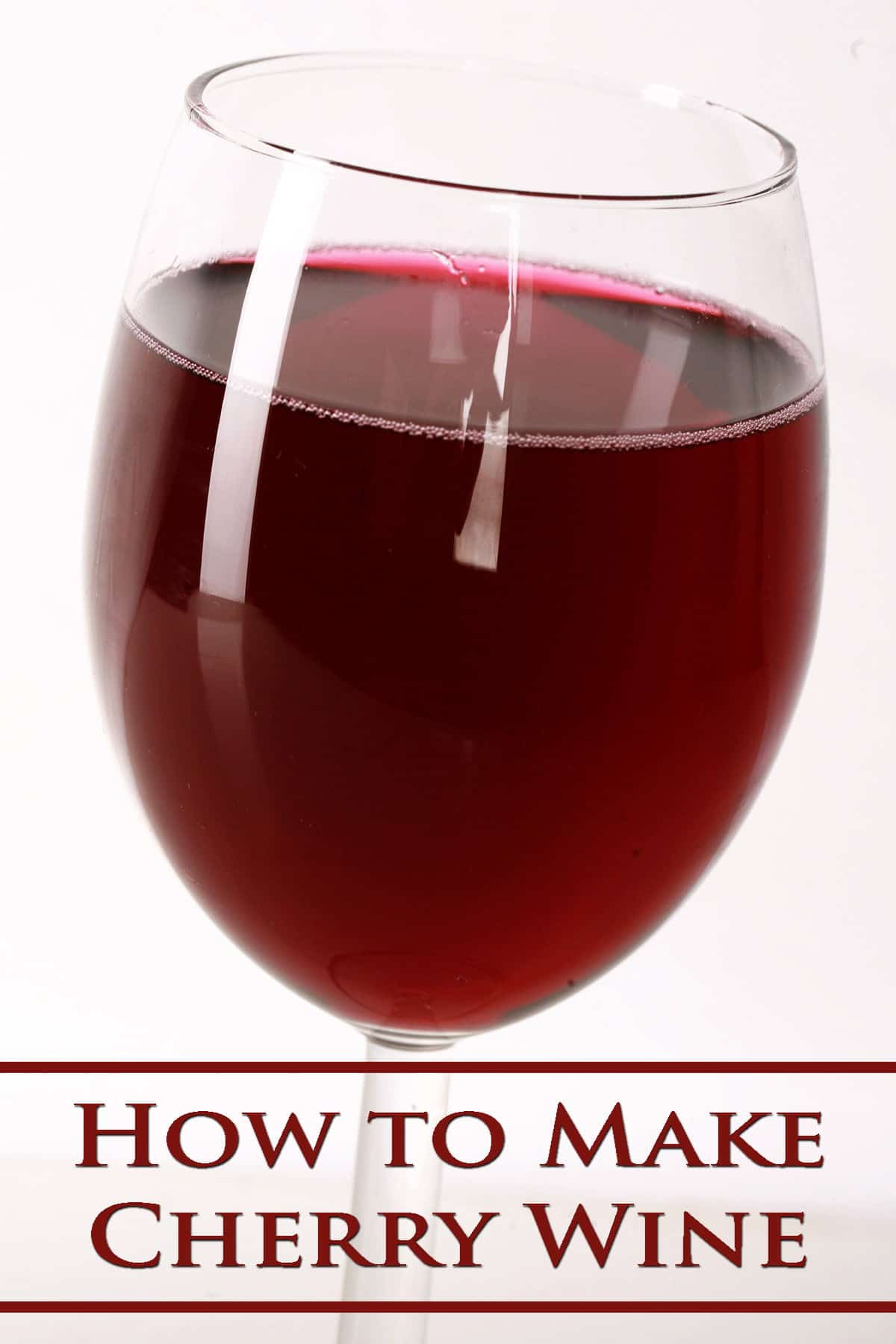 "Close up view of a glass of red wine, labelled with ""How to Make Cherry Wine"""