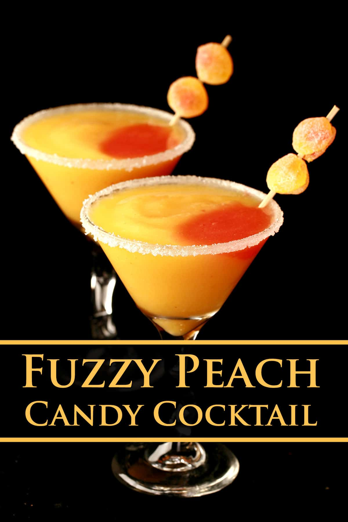 Two martini cocktail glasses with fuzzy peach candy cocktail - a peach coloured slush with a round section of red slush in it, garnished with gummy candies.