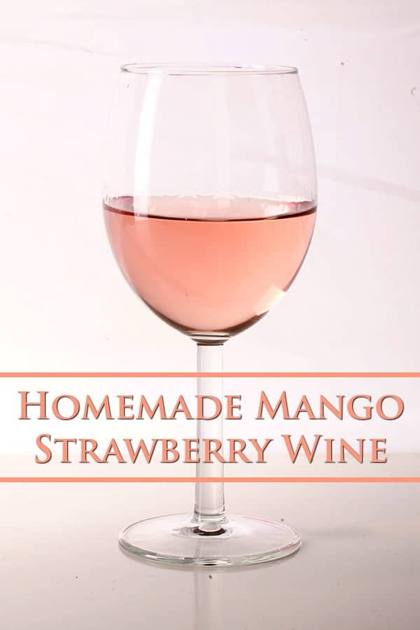 Close up photo of a single glass of pale pink Mango Strawberry wine