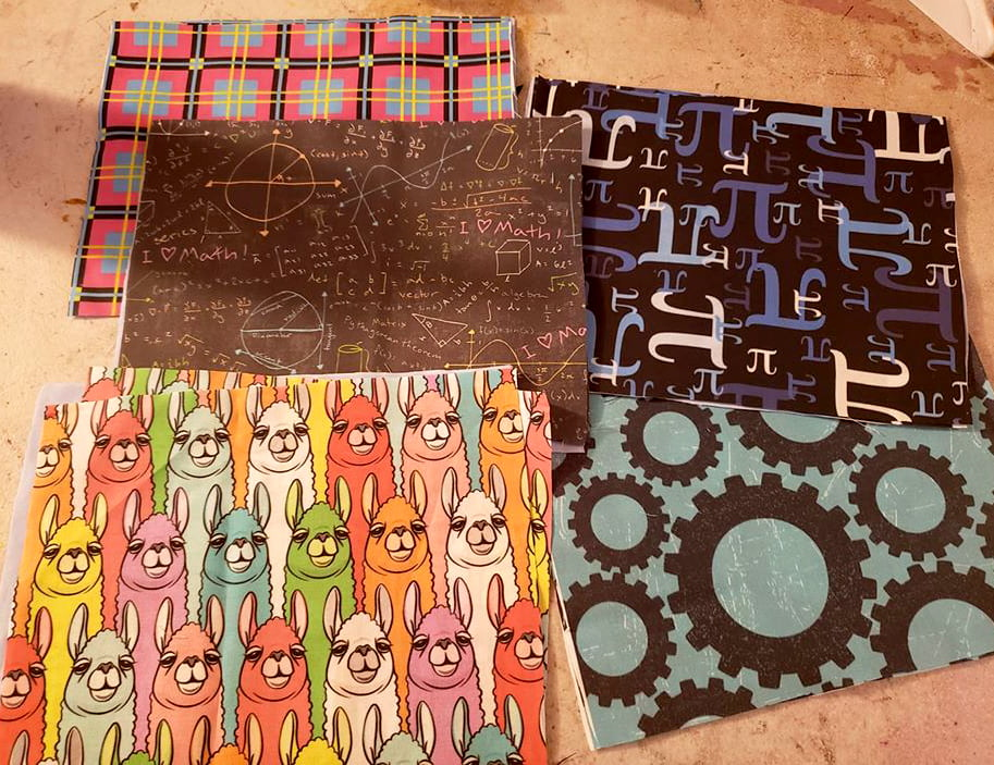 5 squares o brightly coloured fabric