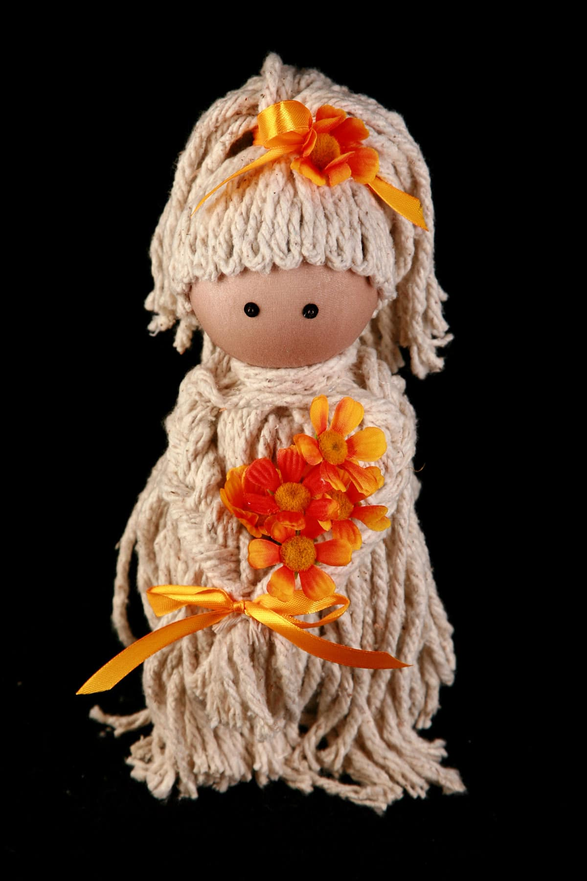 One finished Mop DOll Air Freshener, with Orange ribbons and flowers