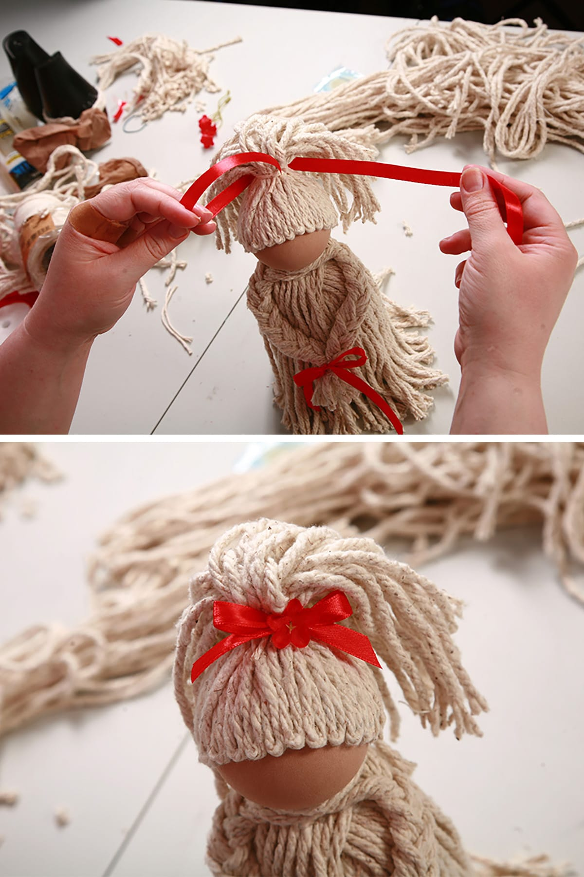 A red ribbon being tied around the ponytail to form a bow.