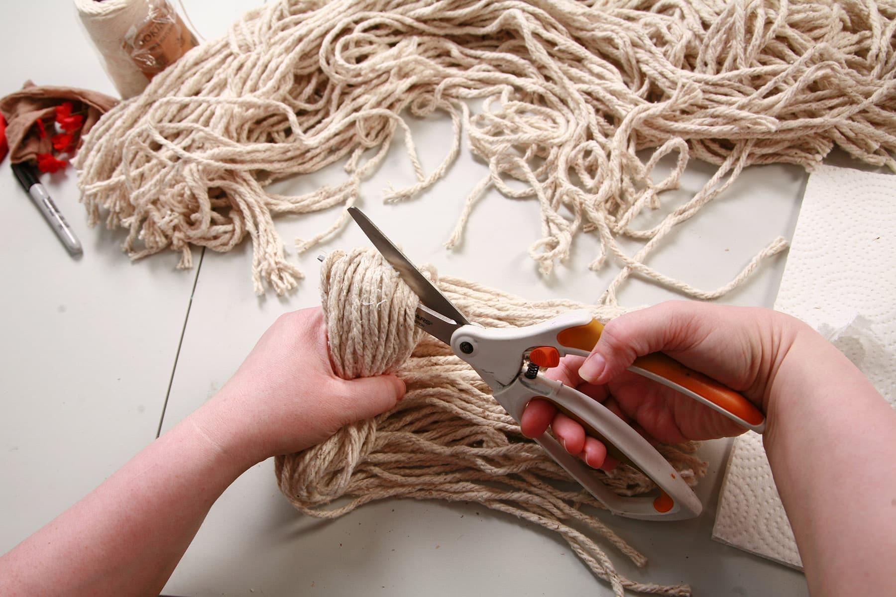 Yarn being cut in half.
