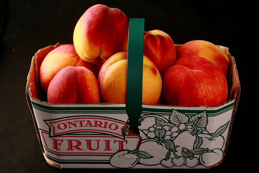 """Basket of Peaches, labelled """"Ontario Fruit"""" on the side"""