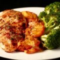 Image of a plate of food: 1 grilled chicken breast - visibly seasoned - grilled peach slices, and broccoli