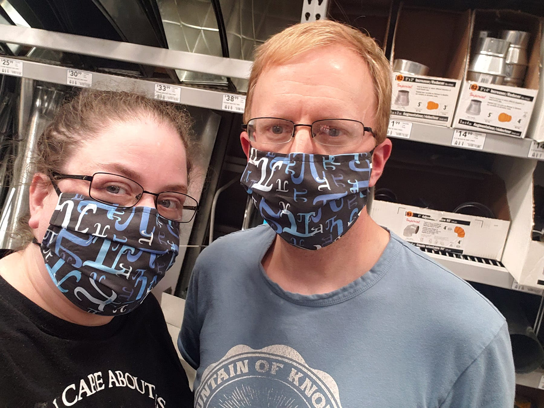 Marie and Michael Porter, weating black, white, and blue pi themed masks.